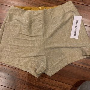 Urban Outfitters glitter gold shorts.